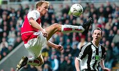 Arsenal's Dennis Bergkamp. So good, he gets a statue of himself doing this.