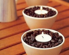 DIY Candle Holder Ideas to Brighten Your HomeThis easy yet sophisticated display is warm and welcoming. Select three small, deep bowls or glass flower pots and fill them to the top with coffee beans choosing a bean flavor that matches the aroma you would like to achieve. Now center a votive candle on top, making sure you nestle it a bit into the coffee beans to help hold it in place.