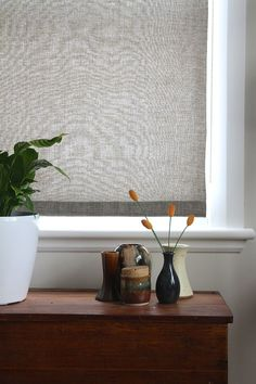 Custom blinds would have cost a mint, so I had a go at DIY fabric roller blinds and I'm pleased with the results.