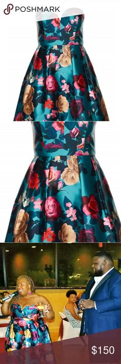 City Chic floral dress Teal, fuchsia, marroon,gold, and navy floral dress. Worn once for my Anniversary Party.  I didn't have to wear a bra. It has great boning at the top. It also has pockets. Size 24. I were a 22 but this ran small so I up sized. Dresses