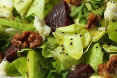 Avocado and Roasted Beet Salad - a delicious and beautiful combination. Add goat cheese, honeyed-walnuts and a spectacular lemon poppyseed dressing for a real winner!