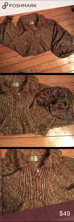 "Cropped sweater poncho Adorable and super funky cropped sweater poncho. Suede ties at each cuff. Brown and green marled knit. Snap buttons. So cute! Measures approximately 16"" long. Excellent condition. Anthropologie Sweaters Shrugs & Ponchos"