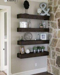 dark wooden floating shelves dressed with various ornaments