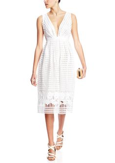 Perforated white dress.