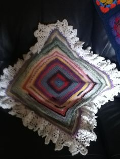 Fancy cushion from left over scraps of yarn.