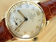 Omega gold with double signed Welsh dial 1938 | Vintage Watches