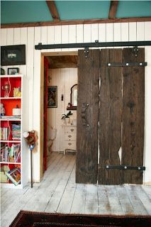 Gorgeous dark reclaimed wood as sliding door