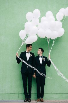 Gay wedding photo of the two grooms with white balloons   #gaywedding #wedding #groom #grooms #balloons