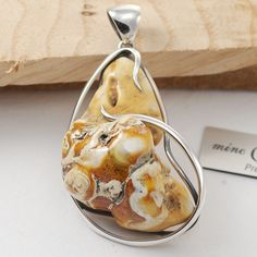 Silver 925 and Unique Amber. Pendant. For sale. Weight: 19.4 grams. Price: 100$.