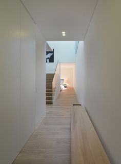 Gorgeous Inspirations for Modern Home Design from Italy: Narrow Hallway With Wooden Bench And White Closet Door Inside The Private House In ...