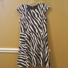 *New listing* Michael  Kors animal print dress Gorgeous animal print fit and flare. The color is brown and off white, detailed with signiture gold hardware. Worn once Michael Kors Dresses