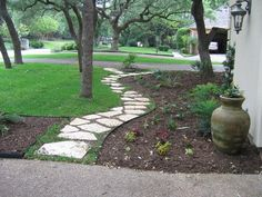 Long flagstone pathway and landscape beds.
