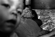 The best photo documentary that I have seen in a long time! THE JULY PROJECT by Darcy Padilla