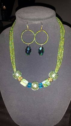 Check out this item in my Etsy shop https://www.etsy.com/listing/207312132/boho-green-necklace-set