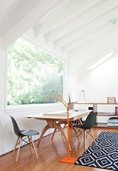 Bright work place with graphic rug.
