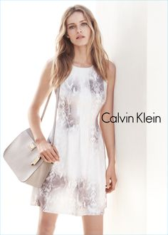 Add structure to a feminine dress with a pebbled leather satchel, as worn by model Edita Vilkeviciute in the Spring 2015 Calvin Klein white label ad campaign.