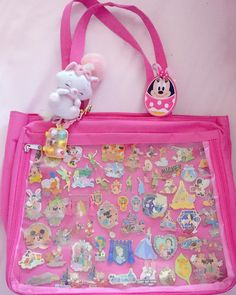 My beautiful Disney pin bag  - Hello Cuties~!! :3 ヽ(*^ω^*)ノ I wanted to share with you my beautiful Disney pin bag I have been working on~!  - I've always wanted to show off my pins and do something with them since they're all on lanyards but I was terrified of loosing them... so.. I picked up another ita bag~!  I then put all my wonderful pins on my new bag .... boy is it heavy but I love it so much~!! (๑╹ω╹๑ ) - Who else here collects Disney Pins!?? :3 I'd love ...