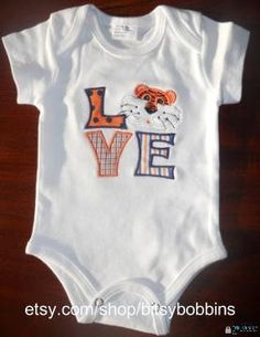 "Auburn Tigers ""LOVE"" applique A-line gingham onesie, t shirt, or dress. $18.00, via Etsy. But maybe in Memphis colors!"