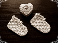 White crochet socks in a retro style.