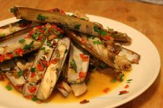 Razor clams with bacon, shallots and red pepper