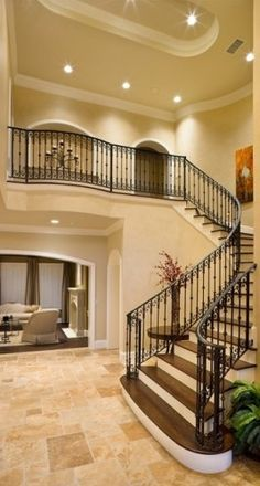 I love the wrought iron stair railing and the hard wood steps!