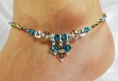 Anklet ankle bracelet made with turquoise blue Swarovski crystals, palladium greyish/brownish luster Czech glass donuts, matching