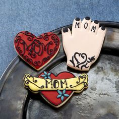 Show Mom how much you care this Mother's Day by getting her name tattooed …on some awesome cookies. Tinted royal icing makes these heart- and hand-shaped cookies a sweet tribute for the rock star in every Mom!