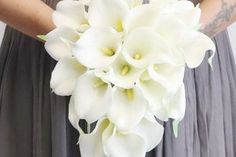 Calla Lilies are a beautiful option for wedding bouqets, and the good news is that you don't need a lot of them to make an impact. Calla Lily Wedding Flowers, Wedding Flowers Cost, Carnation Wedding, Calla Lily Bouquet, Wedding Bouquets, Calla Lilies, Wedding Dresses, Budget Wedding Centerpieces, Calla Lily Centerpieces