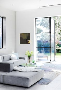 Take a look at the sophisticated revamp of this Melbourne home that was once the stables and maids' quarters for a mansion down the road. Australian Homes, Living Room Inspiration, Black Window Frames, Home, Steel Frame Doors, Big Houses Interior, Melbourne House, Australia House, Living Room Windows