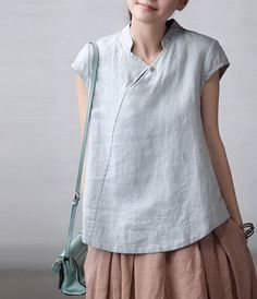 Interesting collar, fastening ans diagonal seam in linen