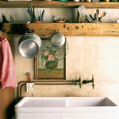 So beautifully primitive with the pipes on the outside of the wall, the rough hewn shelves and that sink!