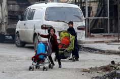 Syria's government forces killing civilians in eastern Aleppo, says UN:     Aleppo  -   Children push containers in strollers as they flee deeper into the remaining rebel-held areas of Aleppo.   Abdalrhman Ismail/Reuters
