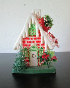 Vintage Kitsch Plastic Brick House with Sleigh and Reindeer Christmas Tabletop Decoration, $15.00