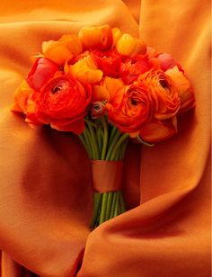 Ranunculus orange wedding flower bouquet, bridal bouquet, wedding flowers, add pic source on comment and we will update it. www.myfloweraffair.com can create this beautiful wedding flower look.