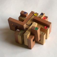 casse-tete - Adelphia - Stephane Chomine Puzzles, Stephane, Nintendo 64, Wooden Toys, Outdoor Chairs, Wood, Letter Case, Wooden Toy Plans, Wood Toys