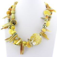 Double strand Murano Glass bead necklace with hues of yellow beads. Materials: Hand-blown Venetian Murano glass beads. - Clasp: Lobster Claw - Length: approximately 20 inches - Extension: approximatel