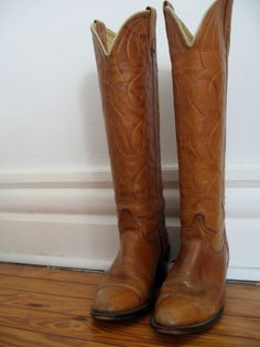Tall vintage cowboy boots....need them! : )
