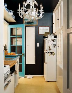 Small kitchen with bold paint choices.
