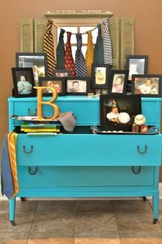 """This was in the entryway and used as a welcome for the guests. It included baby pictures of the Mommy and Daddy-To-Be along with other """"little man"""" touches, books and boy items."""