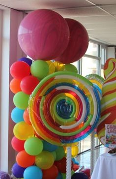 lollipops made with long balloons. I so want to do this theme for next birthday party!