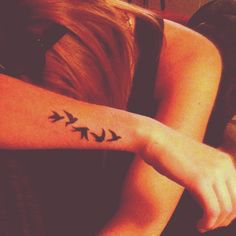 Bird wrist tattoo.