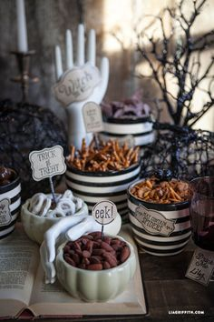 If you're hosting a more casual Halloween affair, you can still deck out your dining table by using free printables to create a spooky spread of your Halloween apps.