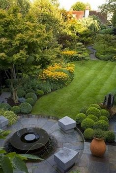 Using Buxus in 'cloud' formations for a magical effect.