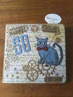 Kaart met grazy cat en gearhead thinlits van Tim Holtz.... Monique Vis