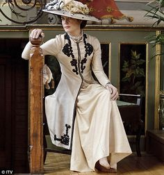 Downton Abbey -- cremes and black = regal Love the long coats (prob not official name) with detailing ooh la la