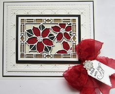 Good morning crafters! Today's card giveaway is another stained glass card (I have loads of them!) I started by cutting the Poinsettia...