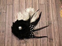 Creamy white and black feather hair clip by stylesbym on Etsy, $10.00