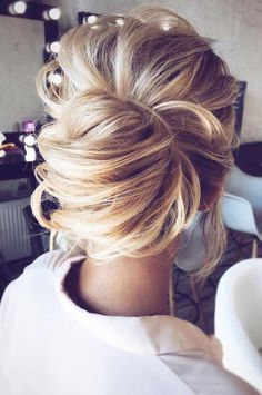 Modern day chignon-style low messy bun updo-- beautiful look for any special occasion.