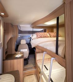 Approach Autograph 765 - side dinette converted in to double bed with electric drop-down double bed above