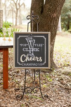 Such a fun sign for a champagne bar! // photo by http://bumbyphotography.com, via http://theeverylastdetail.com/rustic-chic-champagne-purple-wedding-inspiration
